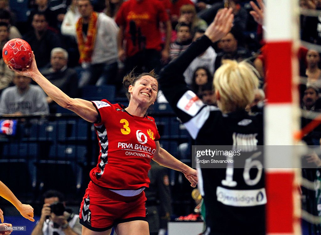 Biljana Pavicevic of Montenegro (L) jump to score near goalkeeper Katrine Lunde Haraldsen (R) of Norway during the Women's European Handball Championship 2012 gold medal match between Norway and Montenegro at Arena Hall on December 16, 2012 in Belgrade, Serbia.