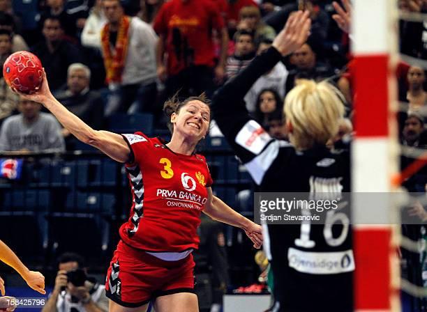 Biljana Pavicevic of Montenegro jump to score near goalkeeper Katrine Lunde Haraldsen of Norway during the Women's European Handball Championship...