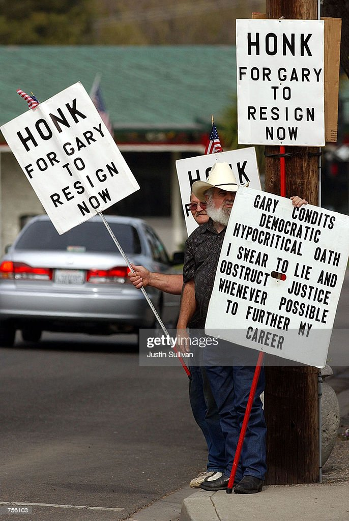 Bill Albers from Ceres CA holds signs protesting Rep Gary Condit on election day March 5 2002 in Modesto CA Condit who is running against five other...