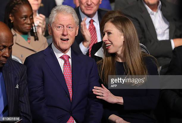 Bill and Chelsea Clinton are seen during the first presidential debate at Hofstra University in Hempstead New York on September 26 2016 Hillary...