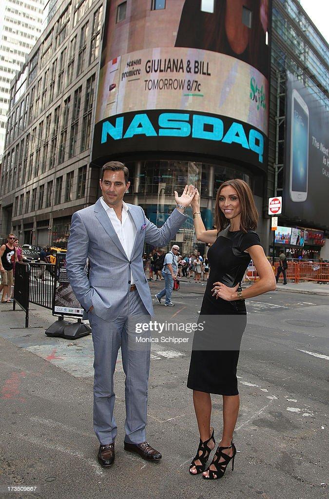 Bill and Giuliana Rancic ring the NASDAQ closing bell at NASDAQ MarketSite on July 15, 2013 in New York City.