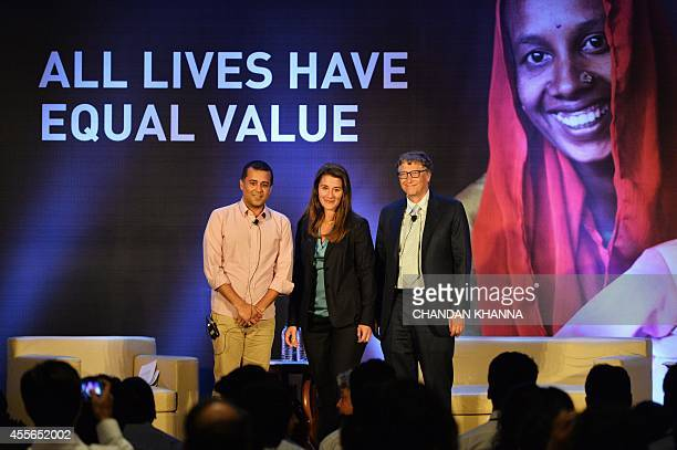 Bill and Melinda Gates of the Bill Melinda Gates Foundation pose with Indian author Chetan Bhagat at an 'All Lives Have Equal Value' event in New...
