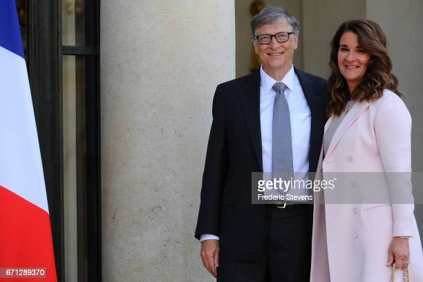 Bill and Melinda Gates pose in front of the Elysee Palace before receiving the award of Commander of the Legion of Honor by French President Francois...