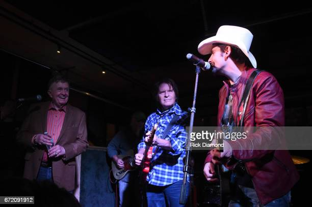 Bill Anderson John Fogerty and Brad Paisley perform onstage at Tootsie's Orchid Lounge after the Brad Paisley LOVE AND WAR Album Launch Event on...