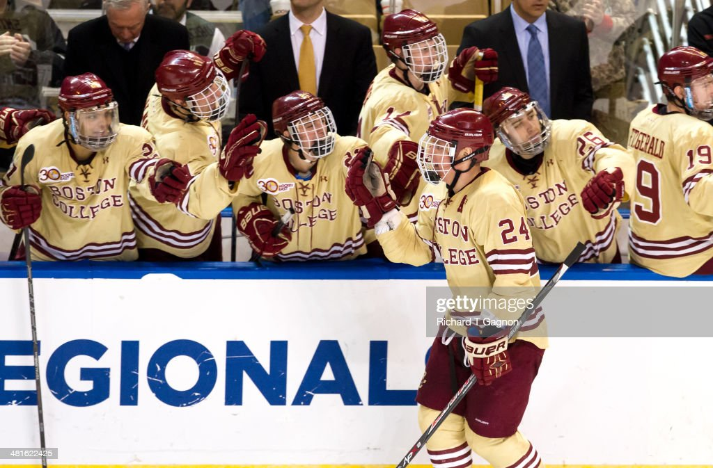 Bill Arnold #24 of the Boston College Eagles celebrates his goal with teammates during the NCAA Division I Men's Ice Hockey Northeast Regional Championship Final against the Massachusetts Lowell River Hawks at the DCU Center on March 30, 2014 in Worcester, Massachusetts.