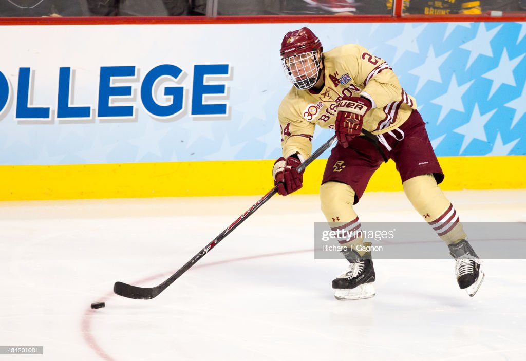 Bill Arnold #24 of the Boston College Eagles passes the puck against the Union College Dutchmen during the NCAA Division I Men's Ice Hockey Frozen Four Championship Semifinal at the Wells Fargo Center on April 10, 2014 in Philadelphia, Pennsylvania.