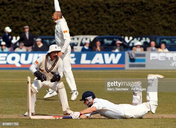 Bill Athey survives a run out attempt by Gloucestershire wicket keeper Jack Russell as Andrew Symonds appeals in the background during today's Benson...