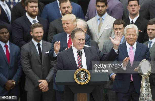 Bill Belichick coach of the New England Patriots football team center gestures while US President Donald Trump third left and Robert Kraft owner of...