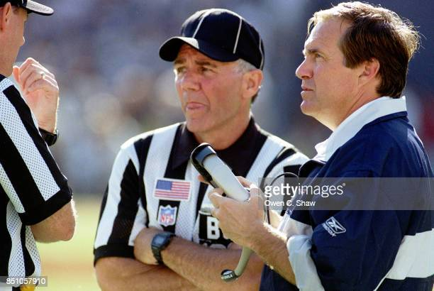 Bill Belichick head coach of the New England Patriots chats with referees at a game against the San Diego Chargers at Jack Murphy Stadium circa 2002...