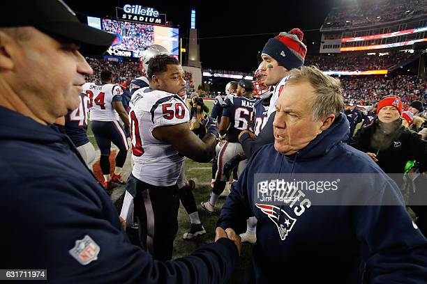 Bill Belichick head coach of the New England Patriots greets Bill O'Brien head coach ofthe Houston Texans after the Patriots defeated theTexans 3416...