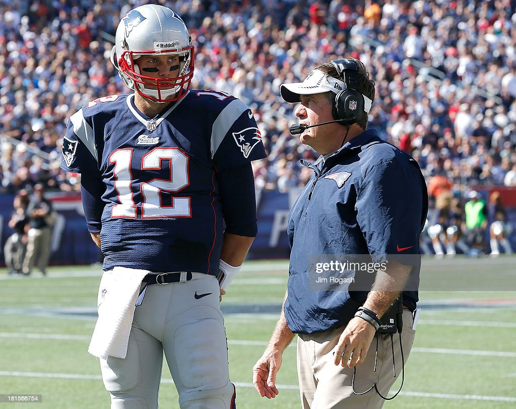 <a gi-track='captionPersonalityLinkClicked' href=/galleries/search?phrase=Bill+Belichick&family=editorial&specificpeople=201822 ng-click='$event.stopPropagation()'>Bill Belichick</a> of the New England Patriots confers with <a gi-track='captionPersonalityLinkClicked' href=/galleries/search?phrase=Tom+Brady+-+American+football-quarterback&family=editorial&specificpeople=201737 ng-click='$event.stopPropagation()'>Tom Brady</a> #12 during a time out in the 2nd half in a game with the Tampa Bay Buccaneers at Gillette Stadium on September 22, 2013 in Foxboro, Massachusetts.