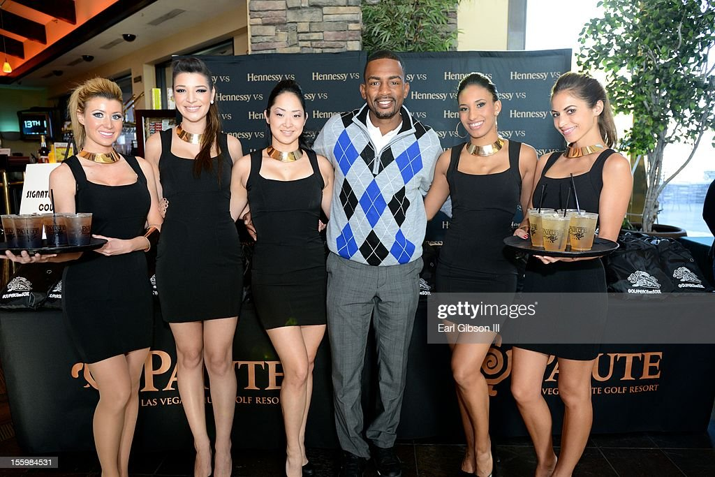 Bill Bellamy poses with some of the Hennessy models at the First Annual Soul Train Celebrity Golf Invitational on November 9, 2012 in Las Vegas, Nevada.