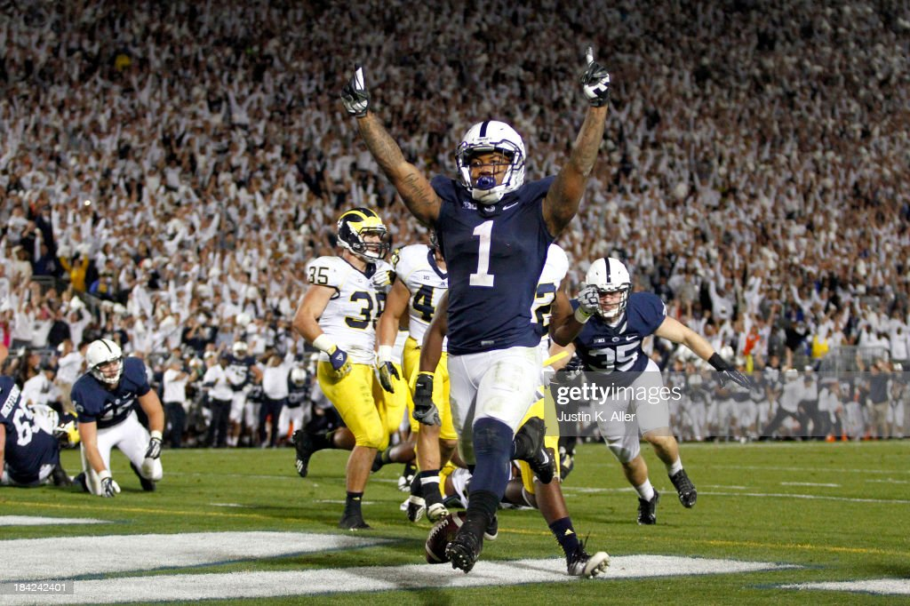 Bill Belton #1 of the Penn State Nittany Lions celebrates after rushing for the game winning touchdown against the Michigan Wolverines during the game on October 12, 2013 at Beaver Stadium in State College, Pennsylvania. The Nittany Lions defeated the Wolverines 43-40 in four overtimes.