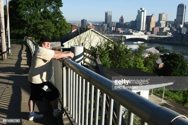 Bill Boback a retired train driver who was born and lived all is life in Pittsburgh is seen with the Downtown area of Pittsburgh Pensylvania in the...