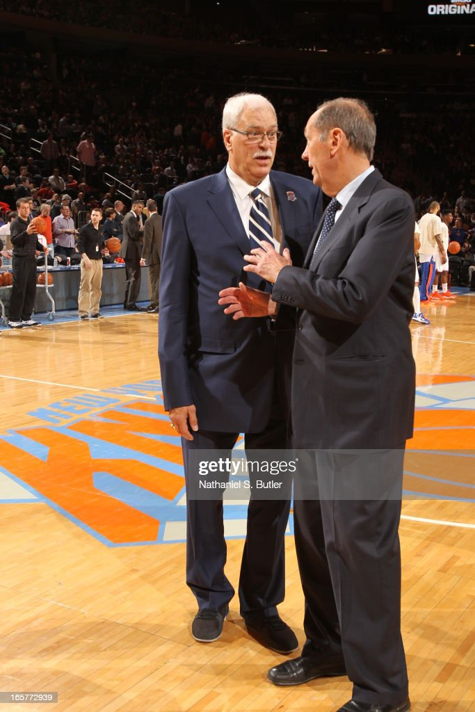 Bill Bradley and Phil Jackson of the 1972 - 1973 Championship New York Knicks team share a word during a ceremony at halftime honoring the 40th anniversary of the team's victory in the NBA Finals on April 5, 2013 at Madison Square Garden in New York City.
