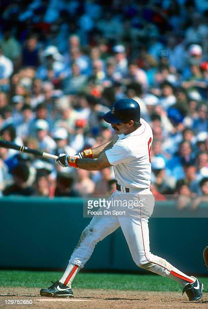 Bill Buckner of the Boston Red Sox bats during an Major League Baseball game circa 1985 at Fenway Park in Boston Massachusetts Buckner played for the...