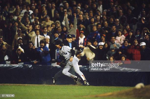 Bill Buckner of the Boston Red Sox lets a ball get through his legs opening to door for an improbable New York Mets comeback during Game 6 of the...