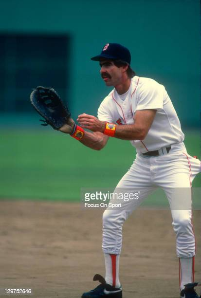 Bill Buckner of the Boston Red Sox looks to make a play on the ball during an Major League Baseball game circa 1984 at Fenway Park in Boston...