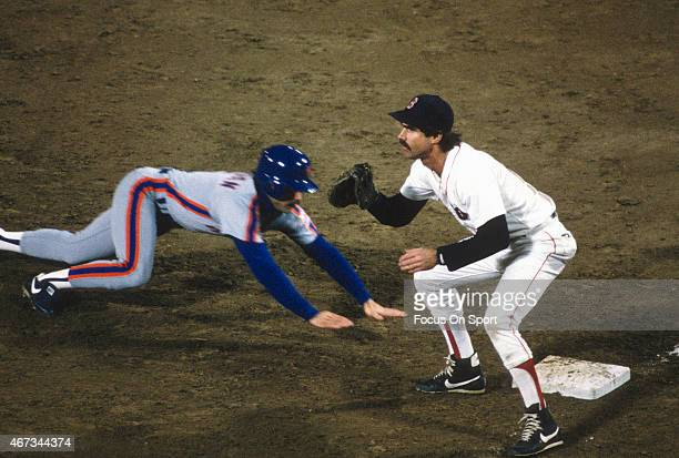 Bill Buckner of the Boston Red Sox takes the throw over to first base against the New York Mets in the 1986 world series in October 1986 at Fenway...