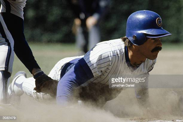 Bill Buckner of the Chicago Cubs slides across a base during a game in the 1980 season at Wrigley Field in Chicago Illinois