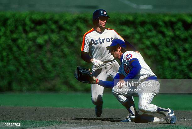 Bill Buckner of the Chicago Cubs takes the throw from the pitcher against the Houston Astros during an Major League Baseball game circa 1981 at...