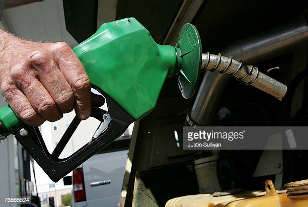 Bill Bydewell prepares to pump fuel into a piece of construction equipment at a Chevron gas station March 12 2007 in San Francisco California...