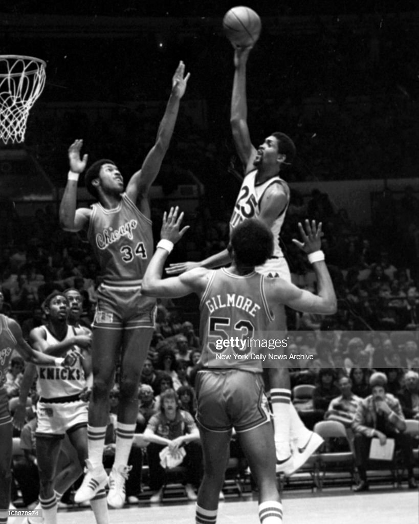 Bill Cartwright of Knicks scores over Dave Greenwood as Artis