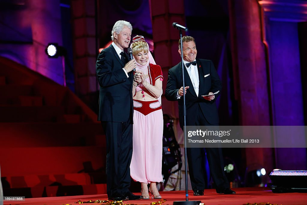 <a gi-track='captionPersonalityLinkClicked' href=/galleries/search?phrase=Bill+Clinton&family=editorial&specificpeople=67203 ng-click='$event.stopPropagation()'>Bill Clinton</a> <a gi-track='captionPersonalityLinkClicked' href=/galleries/search?phrase=Barbara+Eden&family=editorial&specificpeople=206974 ng-click='$event.stopPropagation()'>Barbara Eden</a> and Cornelius Obonya seen on stage during the 'Life Ball 2013 - Show' at City Hall on May 25, 2013 in Vienna, Austria.