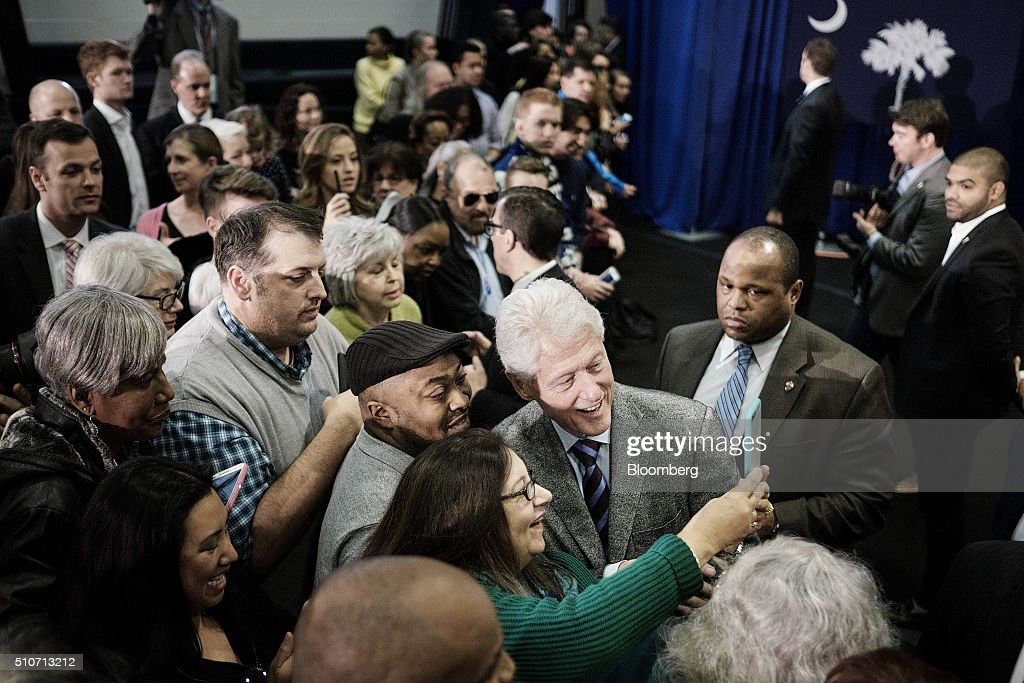 Bill Clinton former US President and husband of 2016 Democratic presidential candidate Hillary Clinton center right takes a selfie photograph with...
