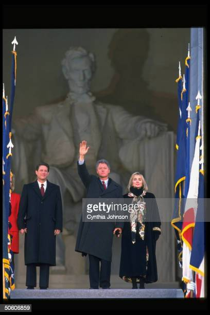 Bill Clinton Hillary Rodham Clinton Al Gore and Tipper Gore waving in front of Lincoln Memorial on inauguration day