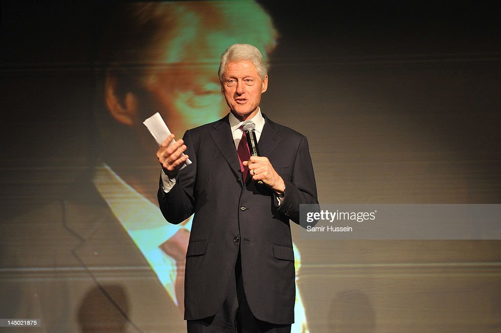 <a gi-track='captionPersonalityLinkClicked' href=/galleries/search?phrase=Bill+Clinton&family=editorial&specificpeople=67203 ng-click='$event.stopPropagation()'>Bill Clinton</a> speaks at 'A Night Out With The Millennium Network' at the Old Vic Tunnels, presented by The Clinton Foundations and The Reuben Foundation. The evening, hosted by <a gi-track='captionPersonalityLinkClicked' href=/galleries/search?phrase=Bill+Clinton&family=editorial&specificpeople=67203 ng-click='$event.stopPropagation()'>Bill Clinton</a>, Chelsea Clinton, Gwyneth Paltrow and Will i Am took place on the 22nd May 2012 in London, England.