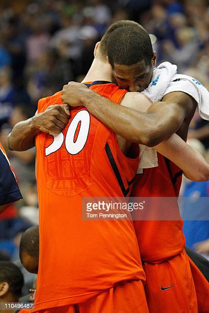 Bill Cole and Mike Davis of the Illinois Fighting Illini hug each other in the final moments of their 5973 loss to the Kansas Jayhawks during the...