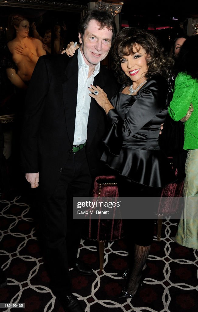 Bill Collins (L) and <a gi-track='captionPersonalityLinkClicked' href=/galleries/search?phrase=Joan+Collins&family=editorial&specificpeople=109065 ng-click='$event.stopPropagation()'>Joan Collins</a> attend the launch of <a gi-track='captionPersonalityLinkClicked' href=/galleries/search?phrase=Joan+Collins&family=editorial&specificpeople=109065 ng-click='$event.stopPropagation()'>Joan Collins</a> new book 'Passion For Life' at No.41 Mayfair Club at The Westbury Hotel on October 21, 2013 in London, England.