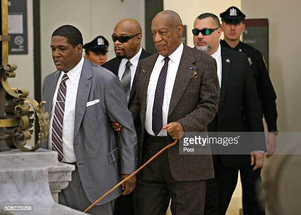 Bill Cosby center and his security team return to Courtroom A after a lunch break during Cosby's pretrial hearing for sexual assault at the...