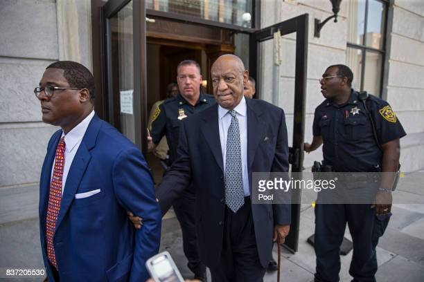 Bill Cosby center leaves the Montgomery County Courthouse led by Andrew Wyatt left and behind his new legal team after details of the new trial were...