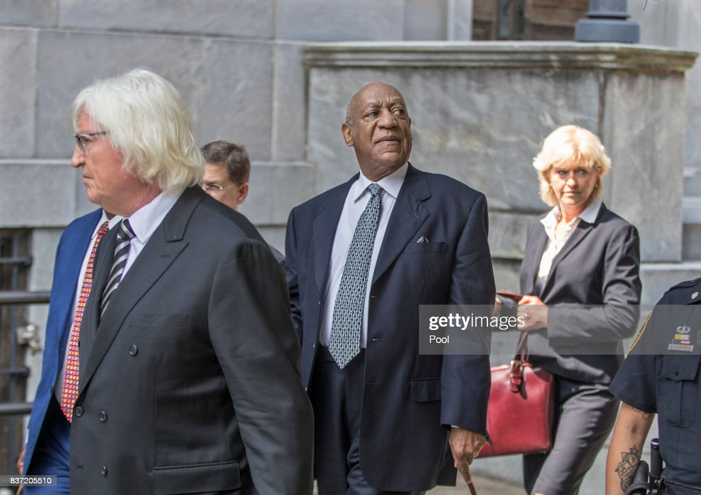 Bill Cosby, center, surrounded by his new legal team, Tom Mesereau, left, and Kathleen Bliss, right, leans his head back to hear words of encouragement from the crowd of onlookers as he leaves the Montgomery County Courthouse August 22, 2017 in Norristown, Pennsylvania. Bill Cosby and his new lawyers will have a hearing in Montgomery County Court about dropping his old counsel, adding his new counsel and if the jury pool will be taken out of county again.