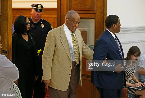 Bill Cosby is led out of Courtroom A after Judge Steven O'Neill ruled against Cosby's lawyers and did not throw the criminal case out at Montgomery...