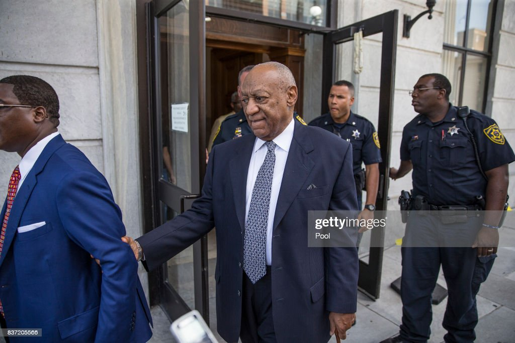 Bill Cosby leaves the Montgomery County Courthouse led by Andrew Wyatt, left, and following his legal team August 22, 2017 in Norristown, Pennsylvania. Bill Cosby and his new lawyers will have a hearing in Montgomery County Court about dropping his old counsel, adding his new counsel and if the jury pool will be taken out of county again.