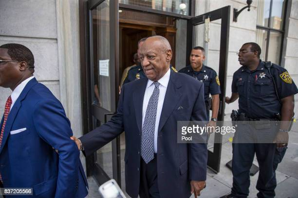 Bill Cosby leaves the Montgomery County Courthouse led by Andrew Wyatt left and following his legal team August 22 2017 in Norristown Pennsylvania...