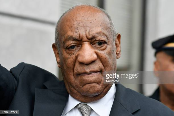Bill Cosby reacts after judge Steven O'Neill declares a mistrial in the aggravated indecent assault trail of entertainer Bill Cosby at Montgomery...
