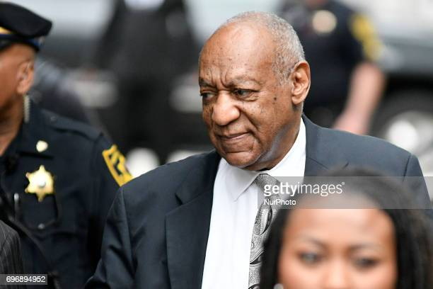Bill Cosby walks in upon arrival for the sixth day of deliberations the aggravated indecent assault trail of the jury at Montgomery Courthouse in...