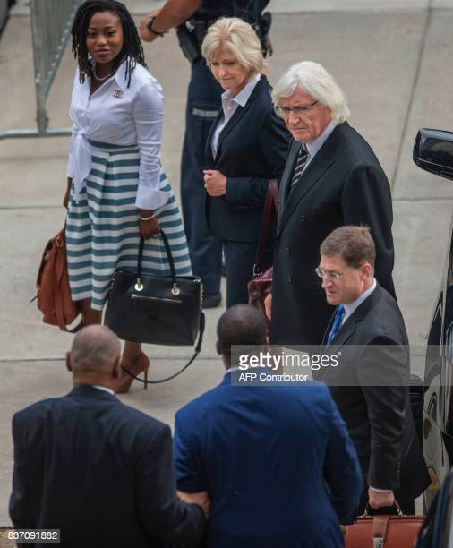 Bill Cosbys new legal team Kathleen Bliss Tom Mesereau and Sam Silver meet him before they all walk in together to the Montgomery County Courthouse...
