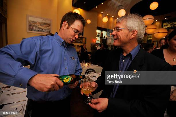 OCT19 2009 Bill Covaleski President and Brewmaster of Victory Brewing in Pennsylvania pours a one of his beers for Mark Snyder Brewers Association...