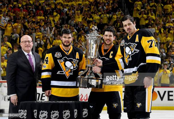 Bill Daley Chris Kunitz Sidney Crosby and Evgeni Malkin of the Pittsburgh Penguins pose with the Prince of Whales Trophy after defeating the Ottawa...