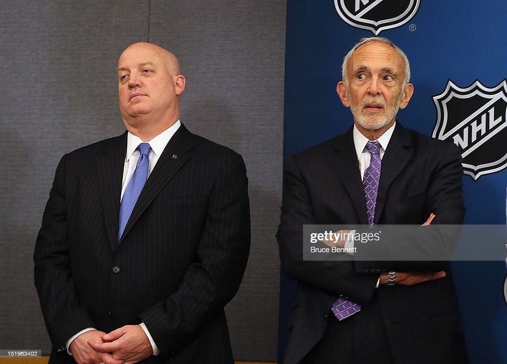 Bill Daly and Bob Batterman of the NHL listen to Commissioner Gary Bettman's media conference at Crowne Plaza Times Square on September 13, 2012 in New York City.