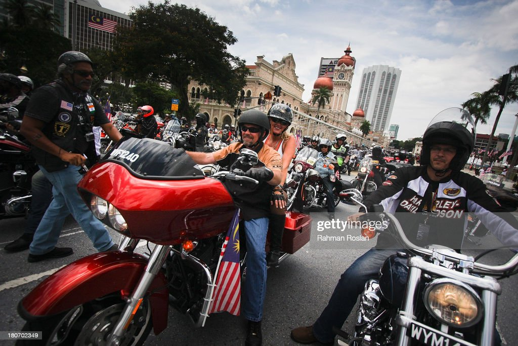 Bill Davidson (C) joins the bike parade in the heart of the city on September 16, 2013 in Kuala Lumpur, Malaysia. Malaysia hosts Asia Harley Days, a first of its kind event in Southeast Asia to engage with not only its consumers, but also with their fans in the region.