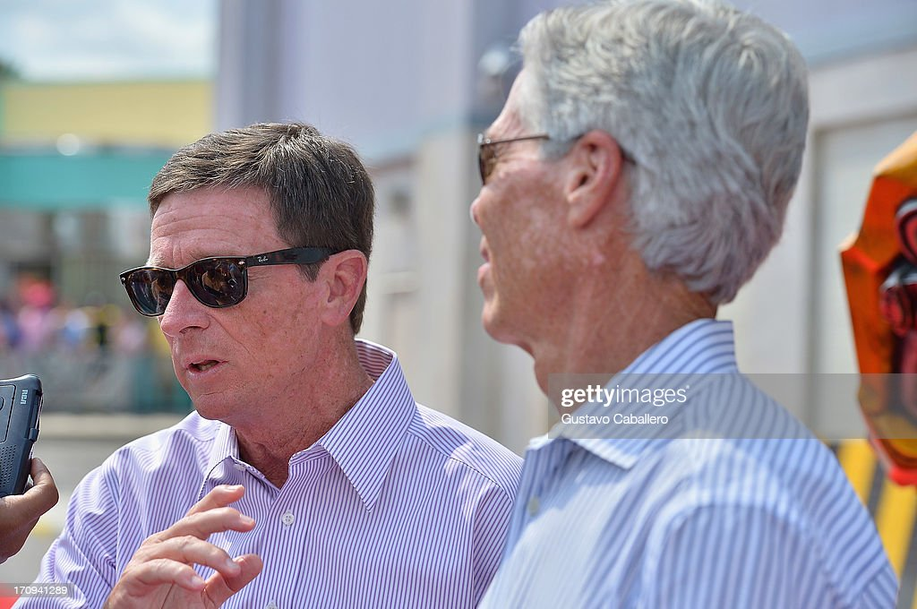 Bill Davis , Chairman of Universal Parks (L) and Resorts and Tom Williams , President and Chief Operating Officer of Universal Orlando Resorts attend Transformers The Ride - 3D Grand Opening Celebration at Universal Orlando on June 20, 2013 in Orlando, Florida.