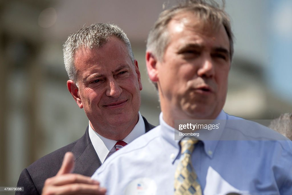 Bill de Blasio, mayor of New York, left, looks on as Senator Jeff Merkley, a Democrat from Oregon, speaks at a news conference surrounded by public officials and labor leaders outside of the U.S. Capitol building in Washington, D.C., U.S., on Tuesday, May 12, 2015. De Blasio unveiled 'The Progressive Agenda to Combat Income Inequality at the news conference.' Photographer: Andrew Harrer/Bloomberg via Getty Images