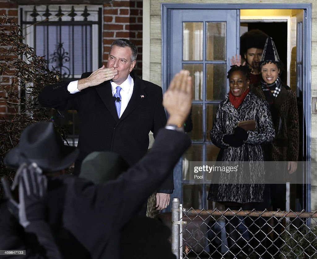 <a gi-track='captionPersonalityLinkClicked' href=/galleries/search?phrase=Bill+de+Blasio&family=editorial&specificpeople=6224514 ng-click='$event.stopPropagation()'>Bill de Blasio</a> waves as he exits his house with his family for his swearing in ceremony after midnight January 1, 2014 in the Park Slope neighborhood of the Brooklyn borough of New York City. De Blasio took the oath outside his home in Park Slope. His inauguration will be celebrated at noon today on the steps of City Hall when he takes the oath again, which will be administered by former U.S. President Bill Clinton.