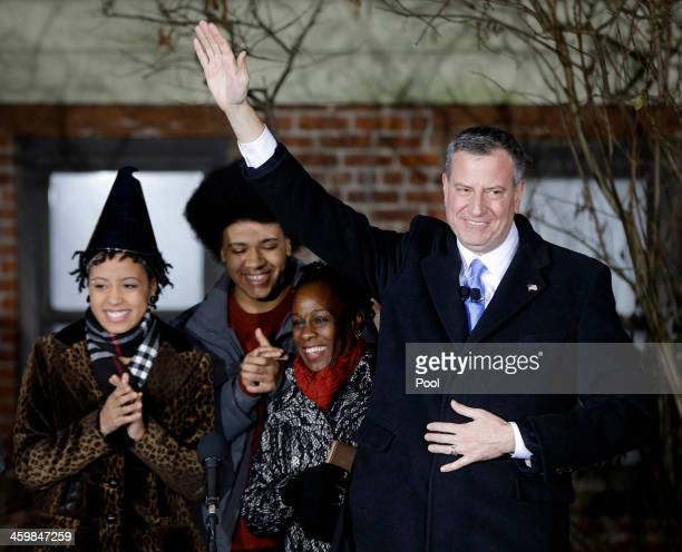 Bill de Blasio waves whilst standing with his family Chiara de Blasio Dante de Blasio and wife Chirlane McCray after being sworn in as mayor of New...